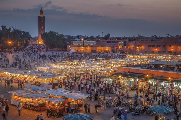 Djemma el Fna, the famous square and market place, at dusk in Marrakech, Morocco.